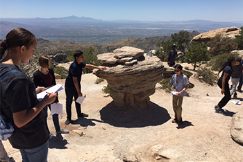 Photo of students studying rocks